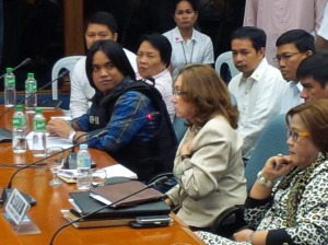 That look. Benhur Luy stares at Ruby Tuason as she testifies before the Senate (February 13, 2014). Photo by Kristine Sabillo