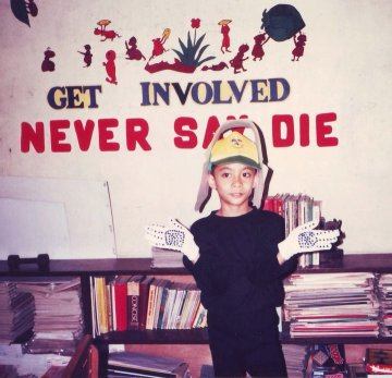 NEVER SAY DIE. In 2011, a year after he joined the New People's Army, Wendell Gumban changed his Facebook profile photo to that of his six-year-old self at a school fair. Note the message on the wall. Photo courtesy of the Gumban family